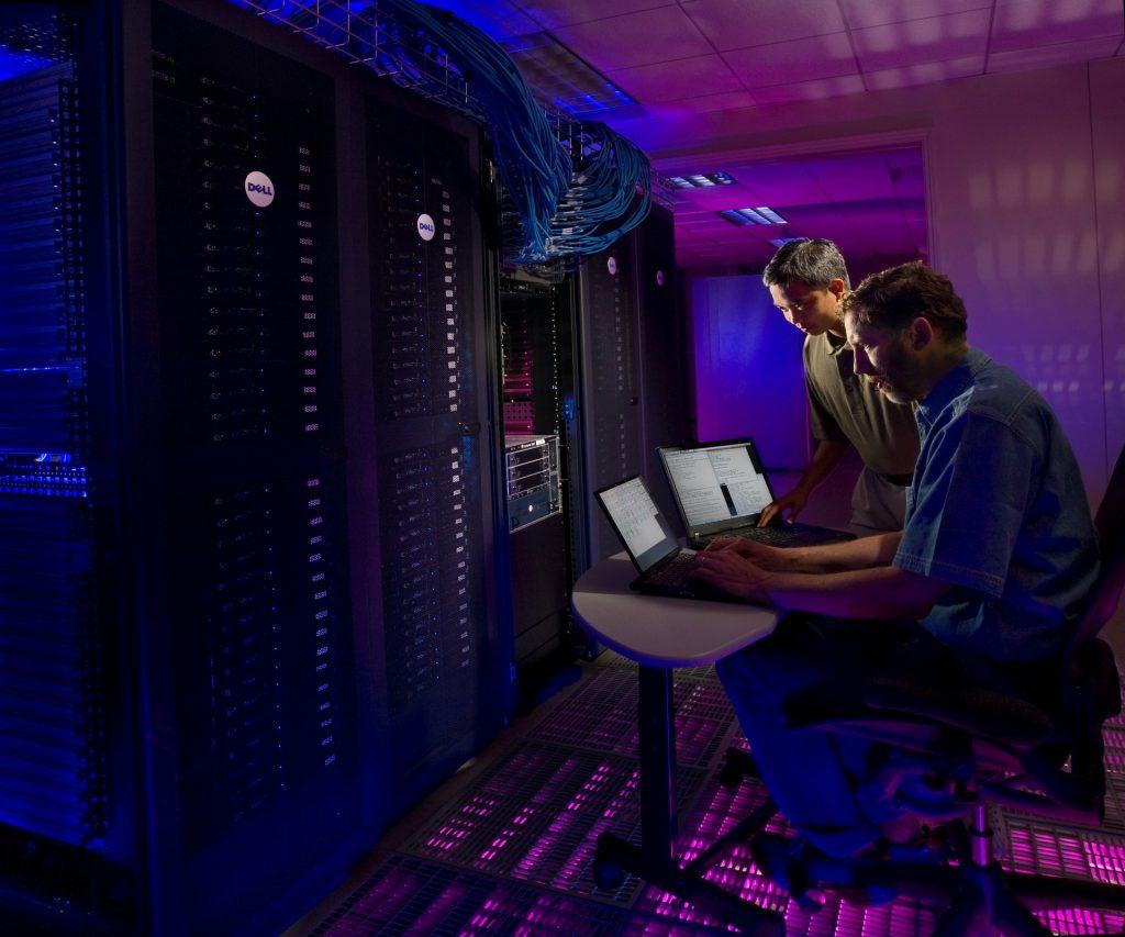 Developers in database servers room